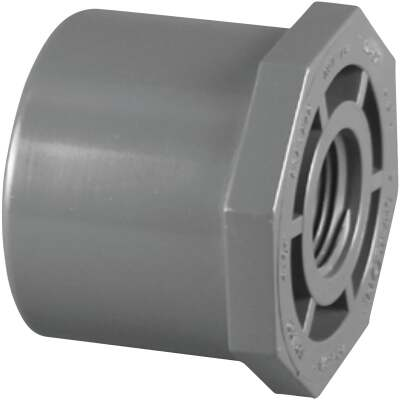 Charlotte Pipe 1-1/4 In. Spigot x 3/4 In. FIP Schedule 80 Reducing PVC Bushing